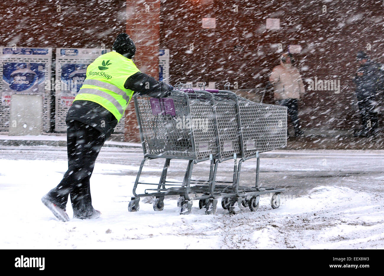 CT USA A worker retrieves carts in the parking lot of Stop