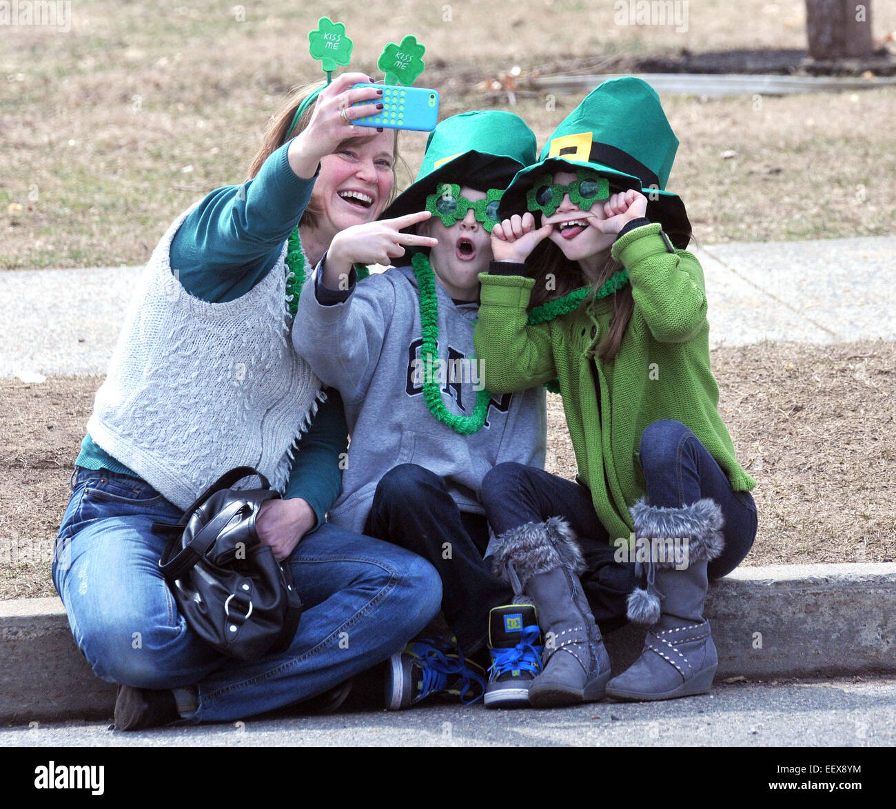 The crowd downtown during the annual Milford St. Patricks Parade, CT USA. - Stock Image