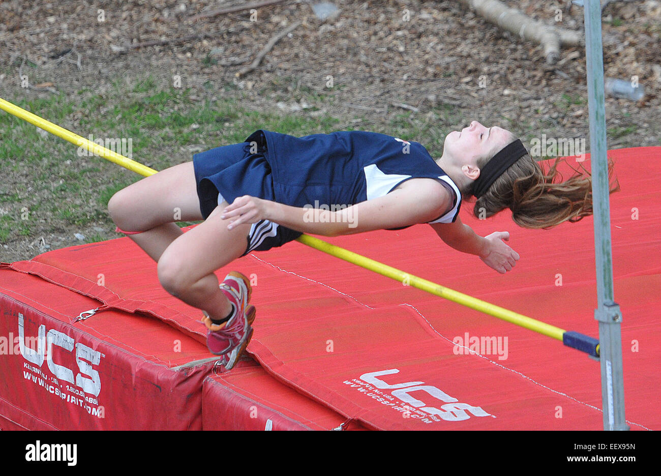 Female High school high jumper in action CT USA - Stock Image