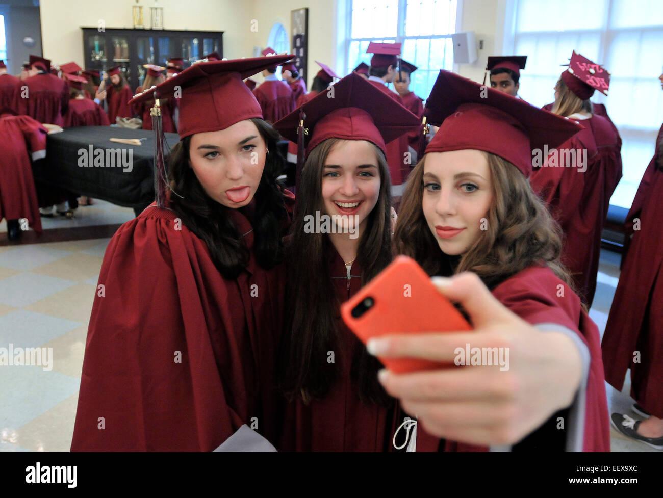 CT USA Graduates Abby Schrader, left, Alisa Pasichnik, center, and Zoe Loewenberg take a 'selfie' before - Stock Image