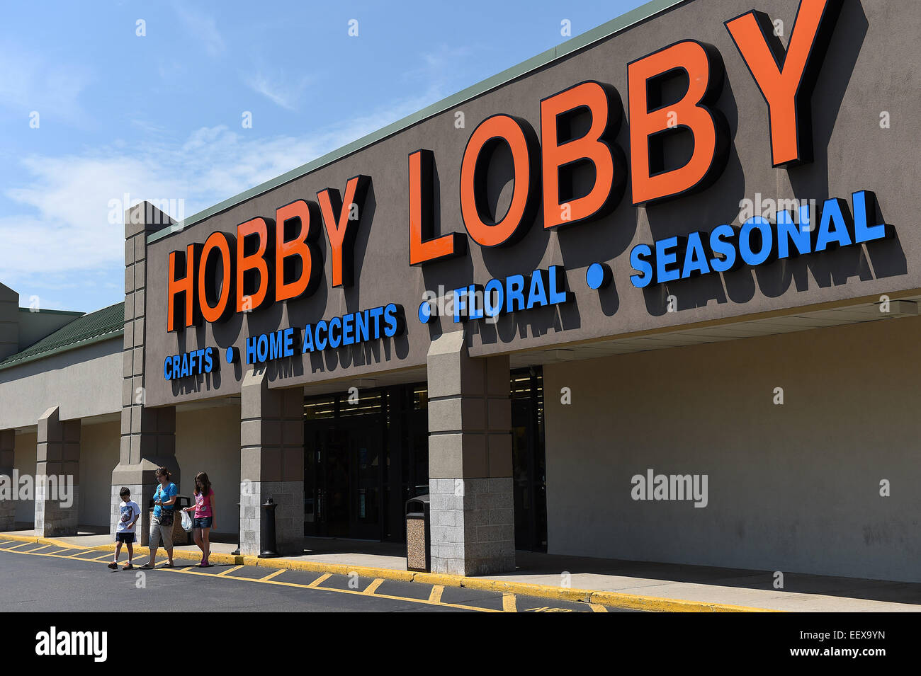 Customers  leave the Hobby Lobby store in East Haven on Monday morning. The U.S. Supreme Court ruled Monday that - Stock Image
