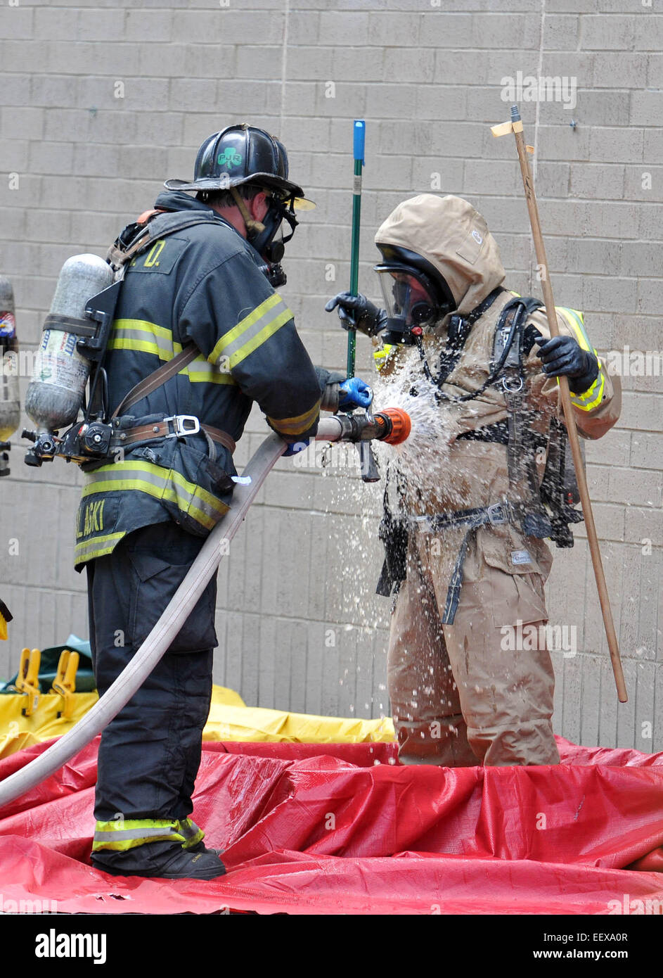 New Haven Firefighters in hazmat suits clean off after a spill at the New Haven Walgreens (York Street) that sent - Stock Image