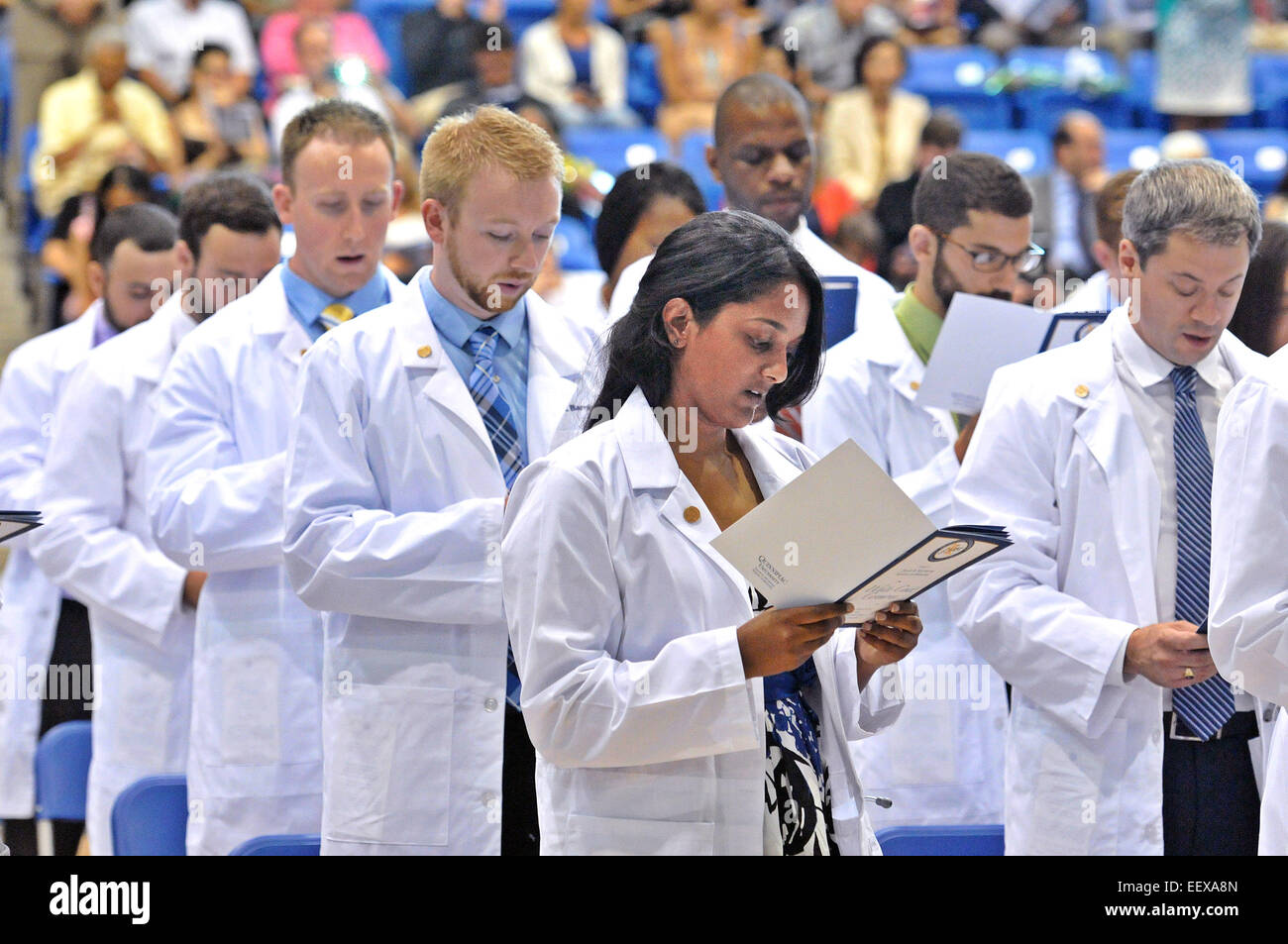 Hamden CT USA 60-New doctors including Aditi Abraham, front, take the Hippocratic oath at a ceremony at Quinnipiac - Stock Image