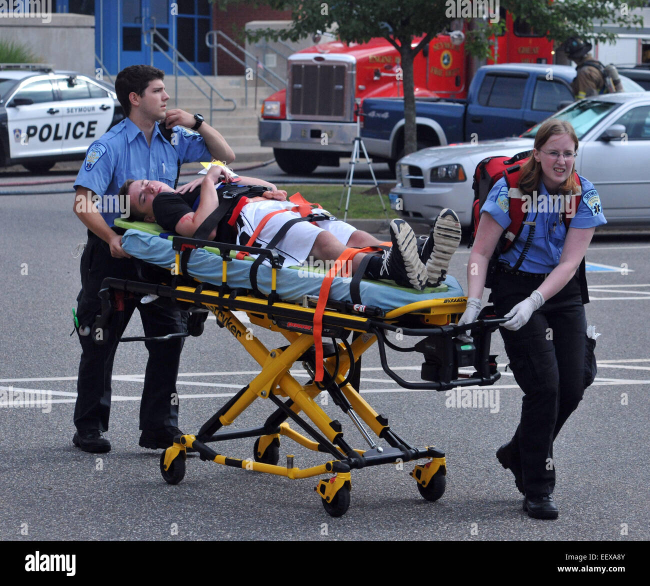 CT USA  EMS workers help a 'victim' during a mock casualty drill at Seymour High School. The drill which - Stock Image