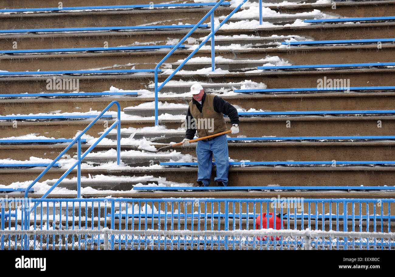 West Haven--A worker clears snow Sunday morning at Ken Strong Stadium, December 15, 2014. The CIAC Class LL football - Stock Image