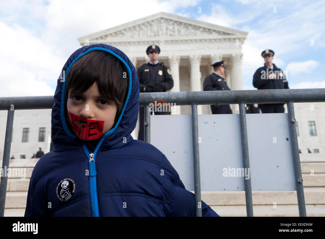 Washington DC, USA. 22nd Jan, 2015. Pro-Life supporters march carrying signs toward the Supreme Court building. - Stock Image