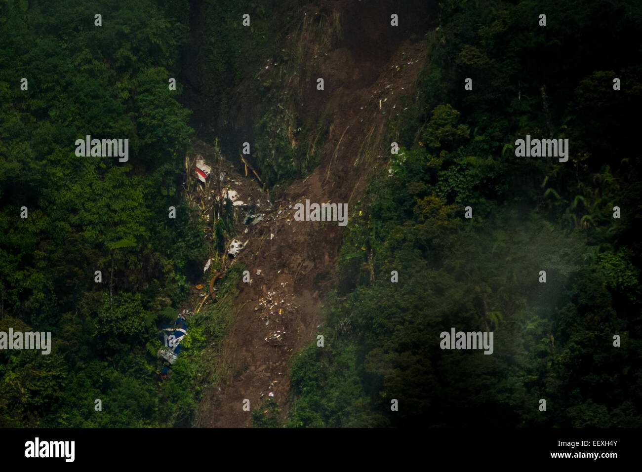 Sukhoi Superjet 100 (SSJ-100) crash site atop Mount Salak, two days after accident. - Stock Image