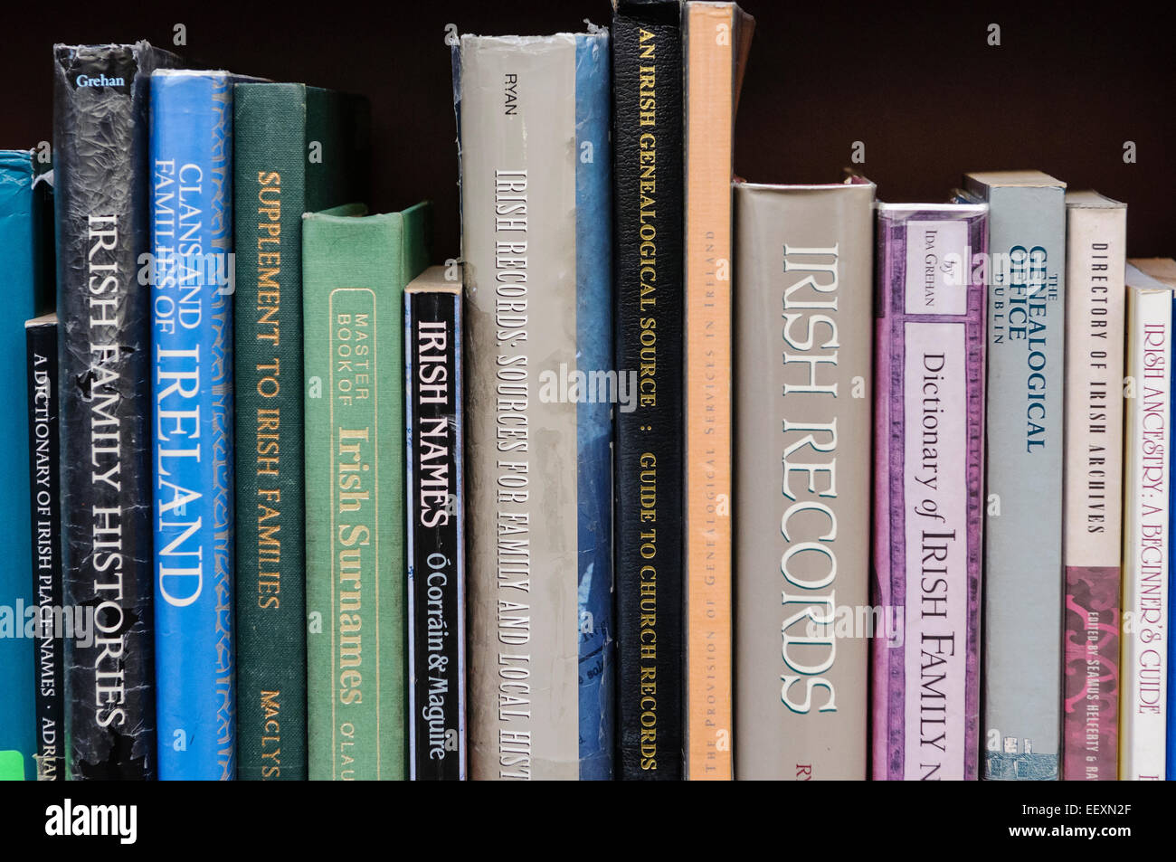 Books on Irish family history and genealogy research in a Belfast library - Stock Image