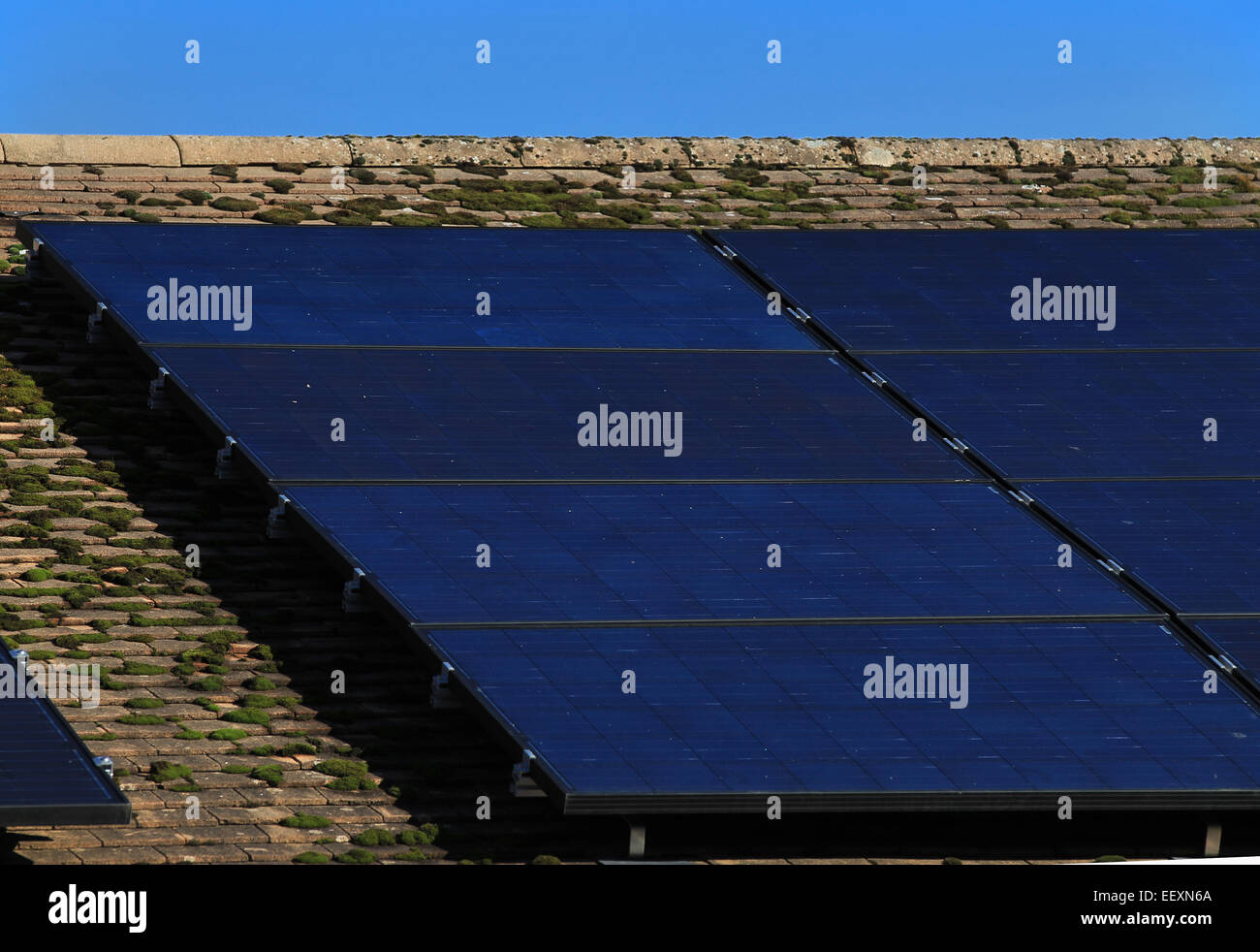 Renewable energy - solar panels on the roof of a residential house - Stock Image
