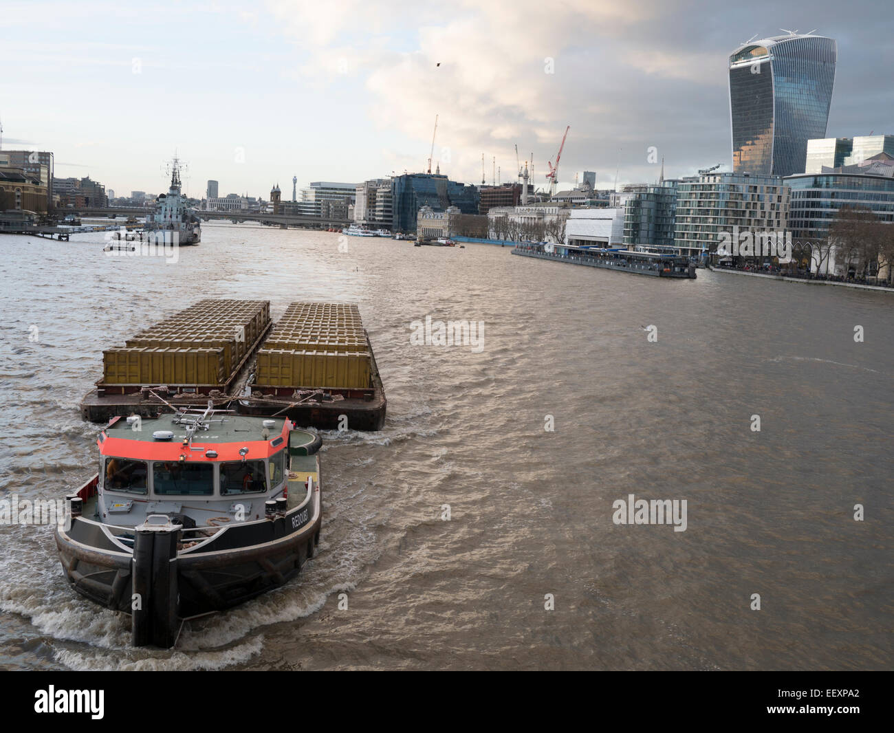 Redoubt tug boat, one of Cory Riverside Thames tug fleet, moving compacted refuse out of the city of London - Stock Image