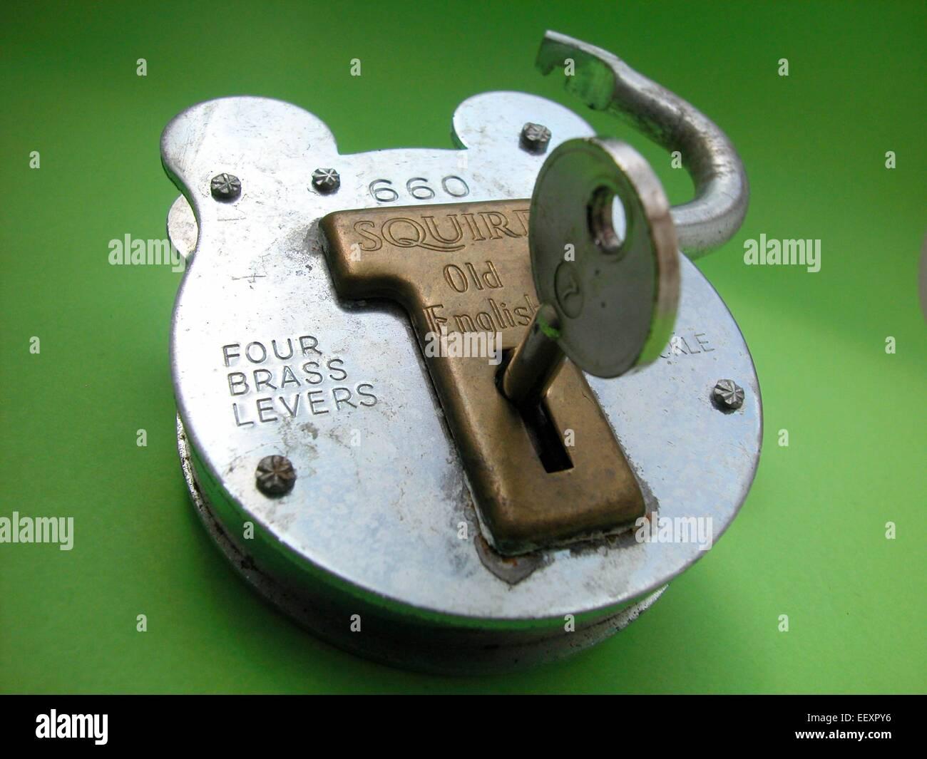 Squire padlock lock unlocked with key - Stock Image