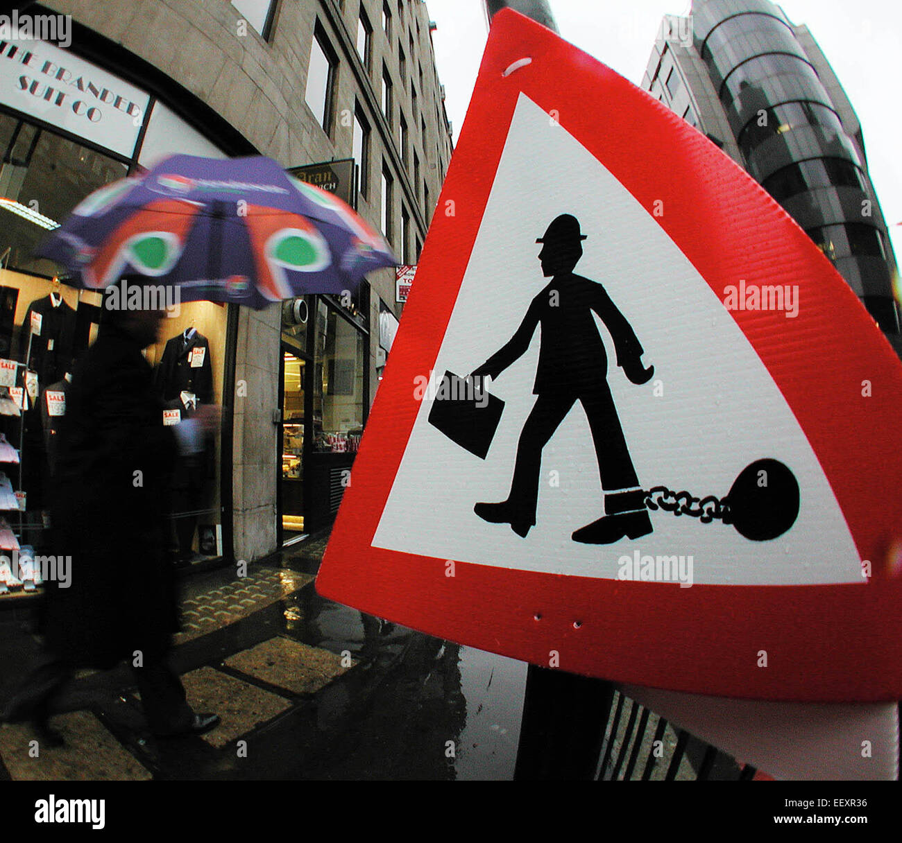 hoax street sign depicting wage slave city office worker trapped imprisoned in ball and chain Cannon Street  London - Stock Image
