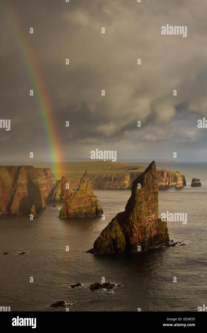 Caithness, Duncansby Head sea stacks with rainbow Stock Photo