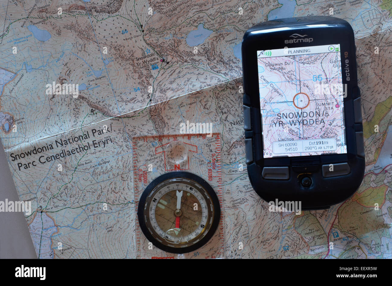 An Ordnance Survey Map, compass and GPS unit - Stock Image
