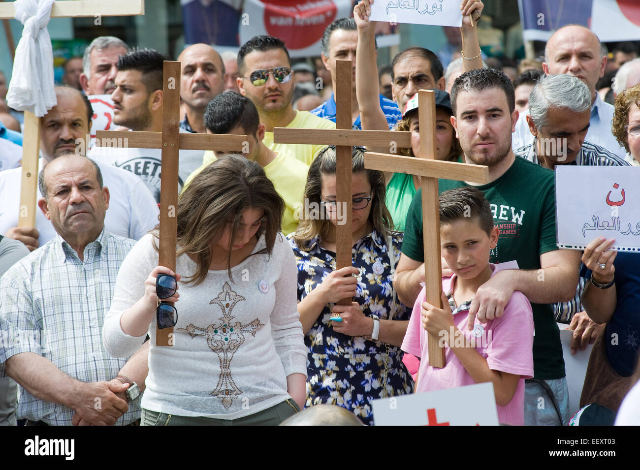 A minute of silence during a demonstration organized by suryoye christians against the slaughter of christians in - Stock Image