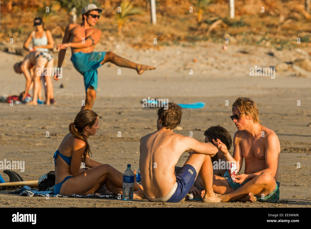 Lively scene at this young surf vibe beach near tourist hub San Juan del Sur; Playa Maderas, San Juan del Sur, Rivas, - Stock Image