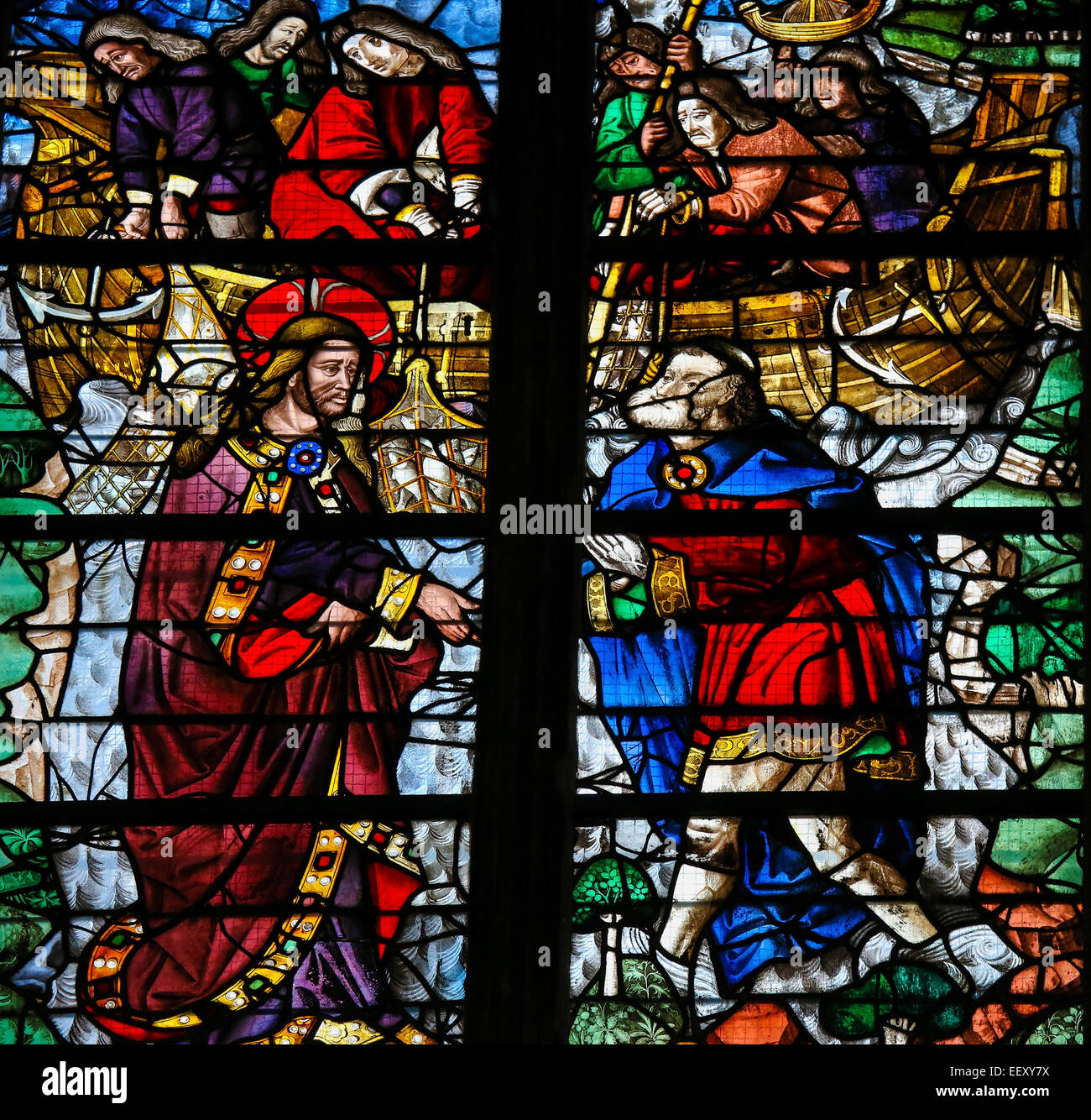 Stained glass window depicting Jesus calling Simon Petrus (Saint Peter) to become a 'fisher of men'  in - Stock Image