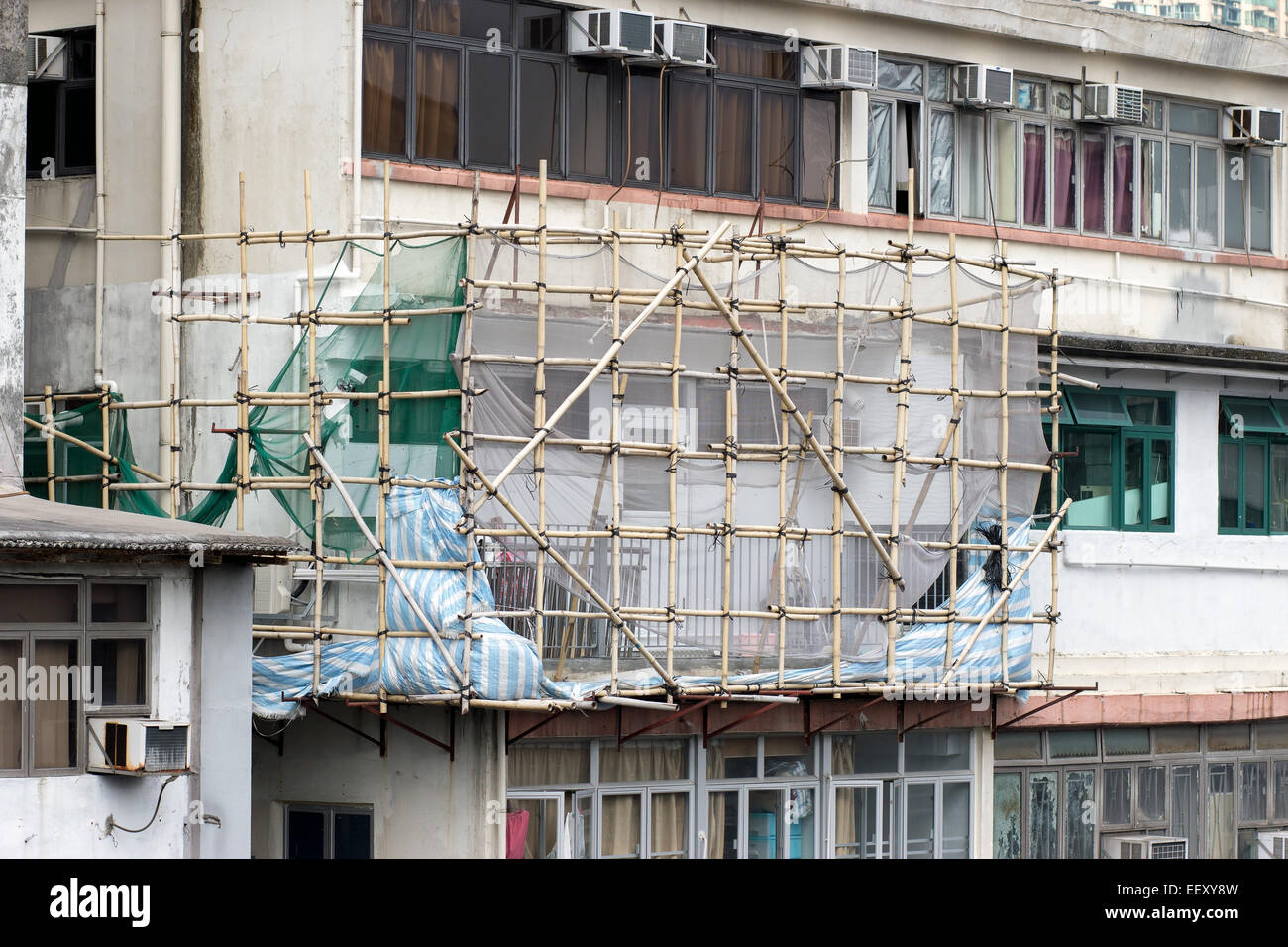 bamboo scaffolding on building height in the streets of Hong Kong - Stock Image