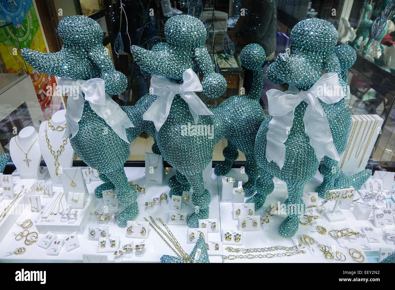 Three bejewelled poodles in a shop display in Benidorm, Spain - Stock Image