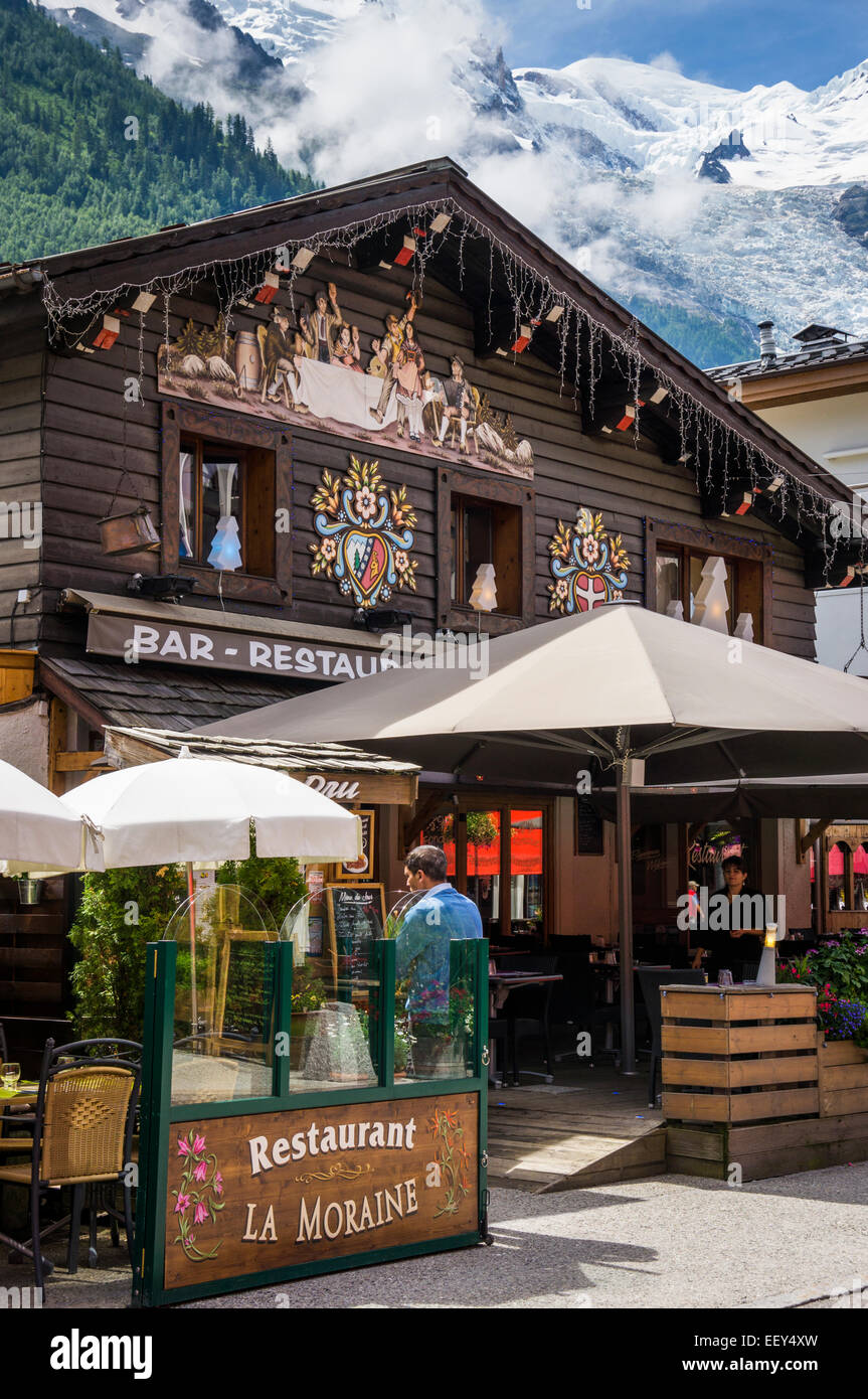 Bar restaurant in Chamonix, French Alps, France - with Mont Blanc behind in summer - Stock Image