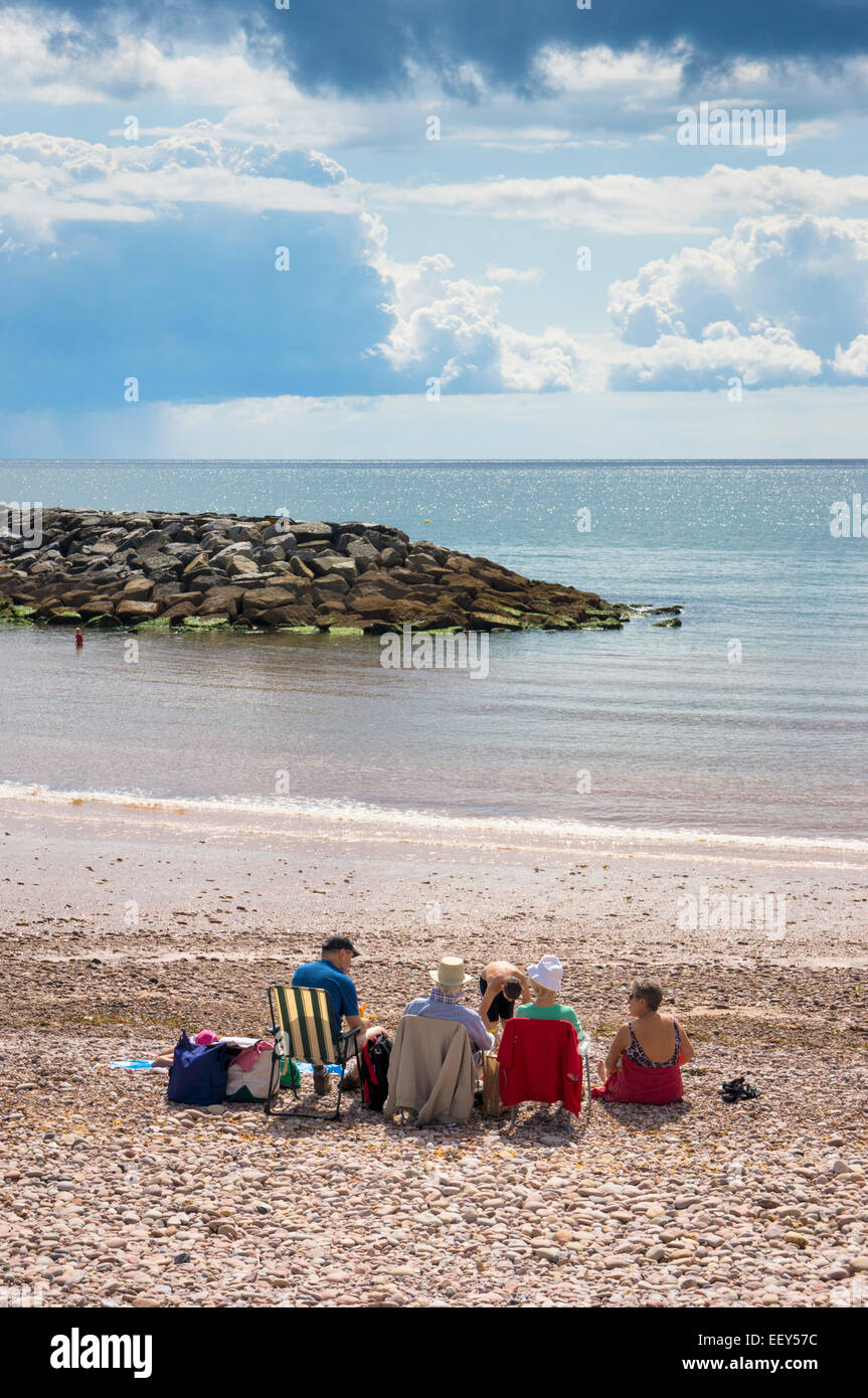 Family on holiday on the beach at Sidmouth, East Devon, England, UK in summer - Stock Image