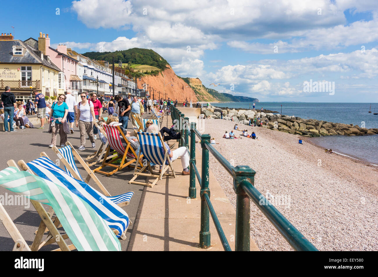 Deckchair on the promenade at Sidmouth, East Devon, England, UK in summer - Stock Image