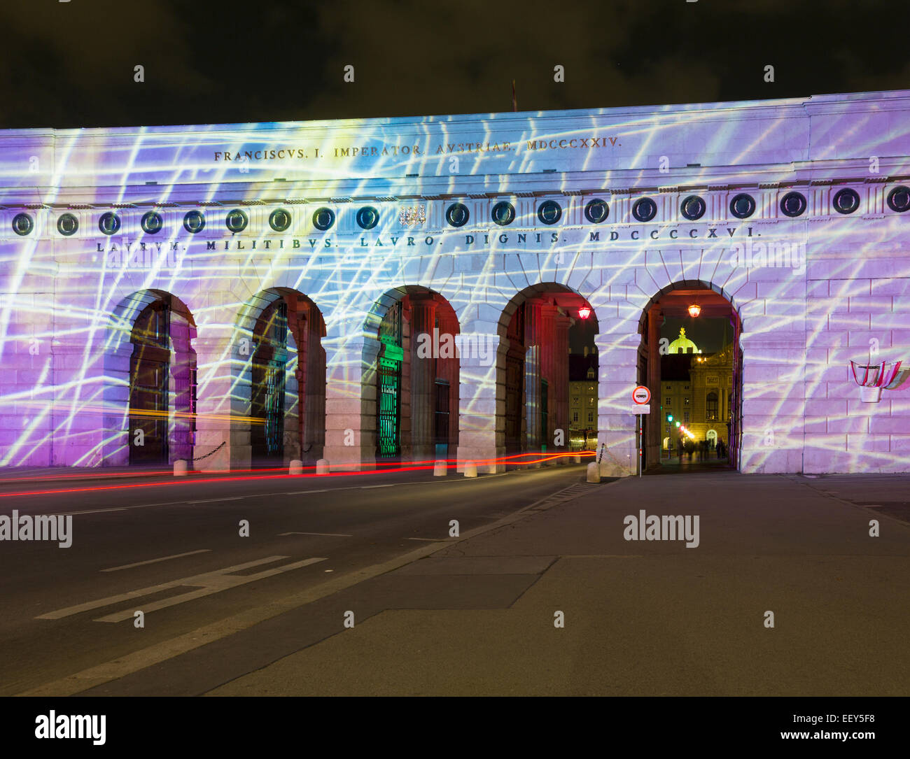 Light show on the ancient outer castle gate and arches in Heldenplatz, Vienna, Austria - Stock Image
