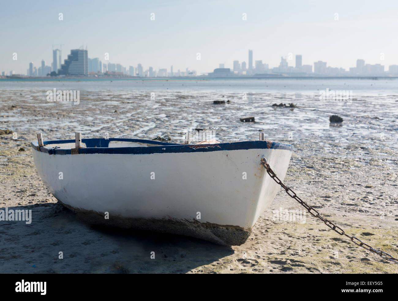 Fishing boat on waterside overlooking Manama, Bahrain, Middle East - Stock Image