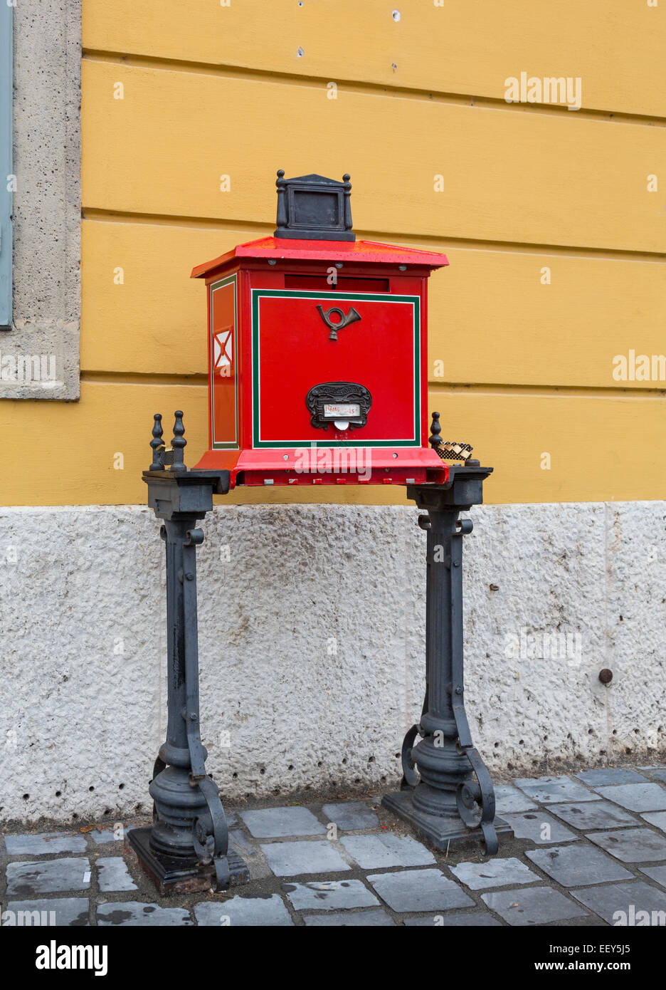 Traditional red Posta post box or mailbox in Castle District in Buda, Budapest, Hungary - Stock Image