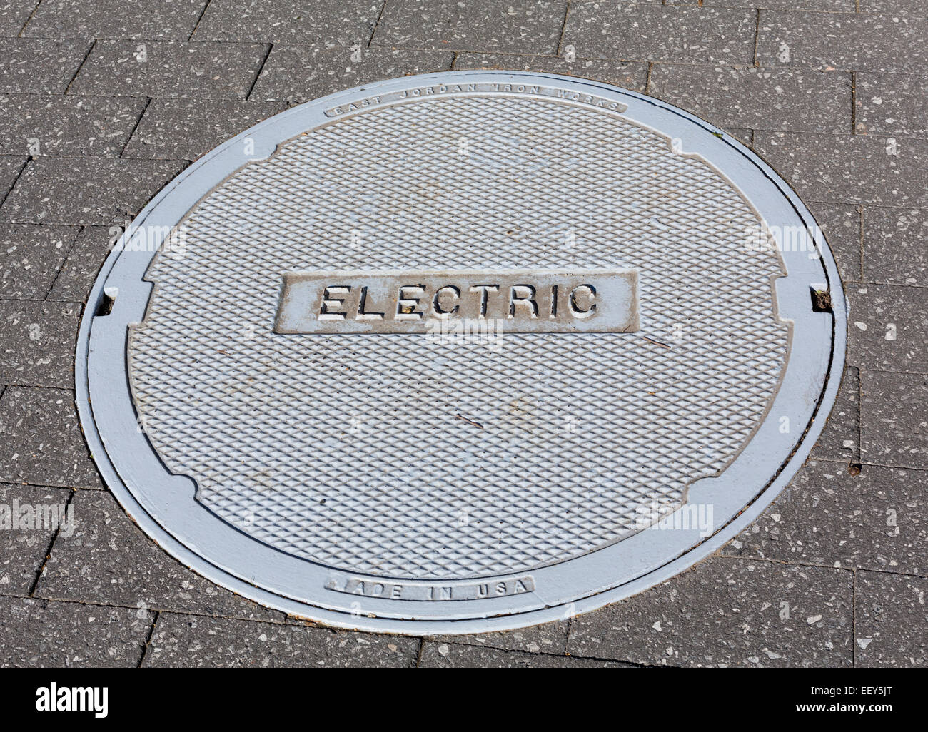 Electric utilities manhole cover - Stock Image
