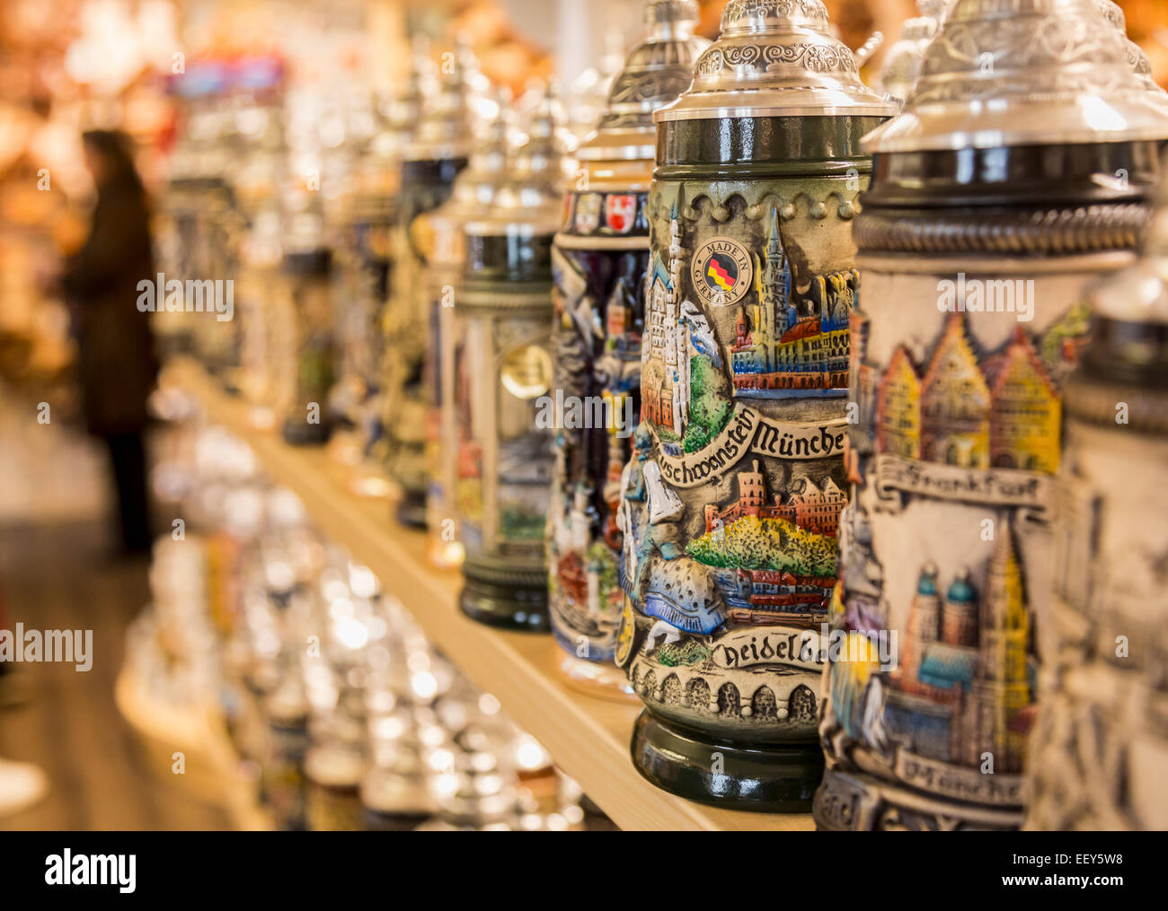 Row of German beer stein or tankards on a shelf in a shop in Regensburg, Bavaria, Germany - Stock Image
