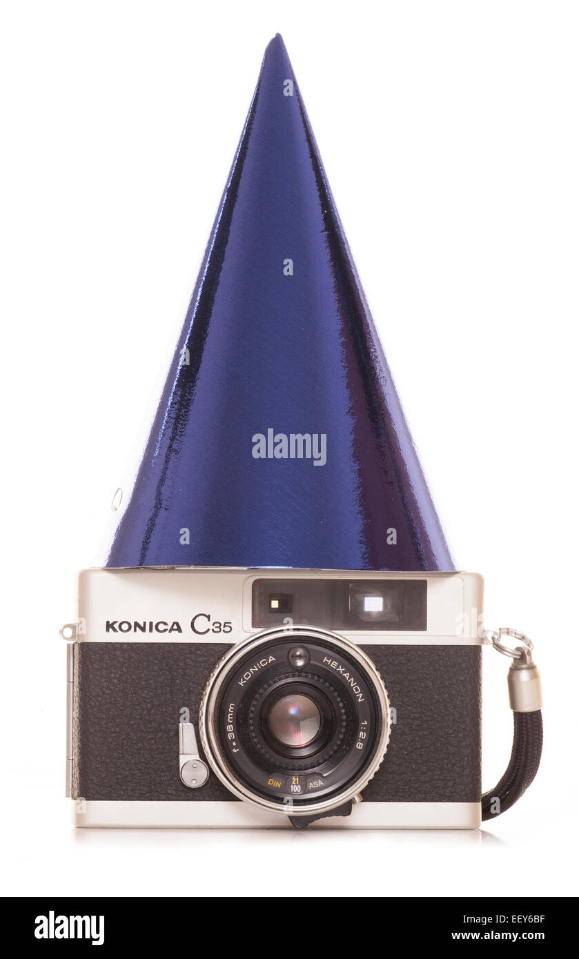 vintage slr film camera with party hat cutout - Stock Image