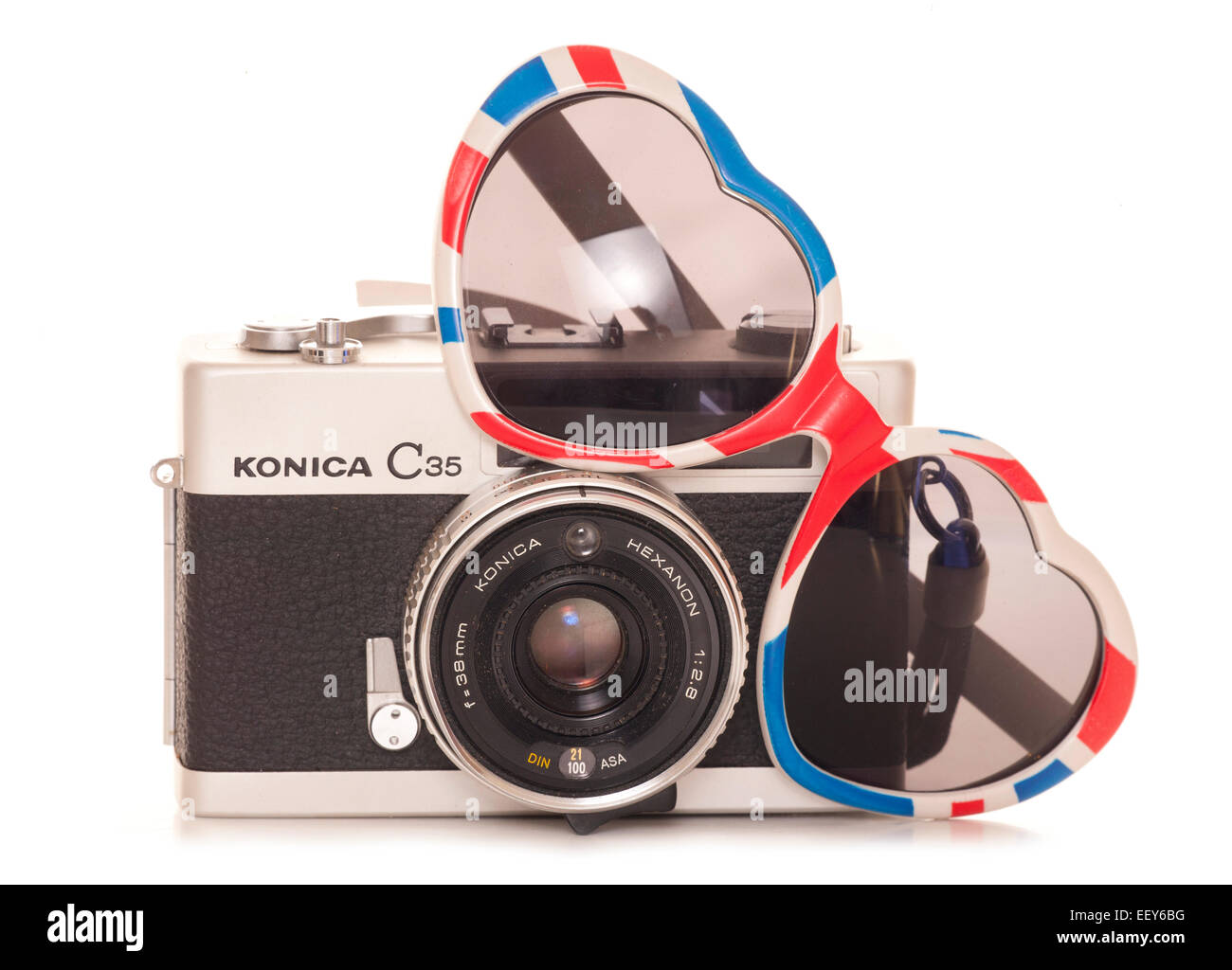 vintage slr film camera with heart sunglasses cutout - Stock Image