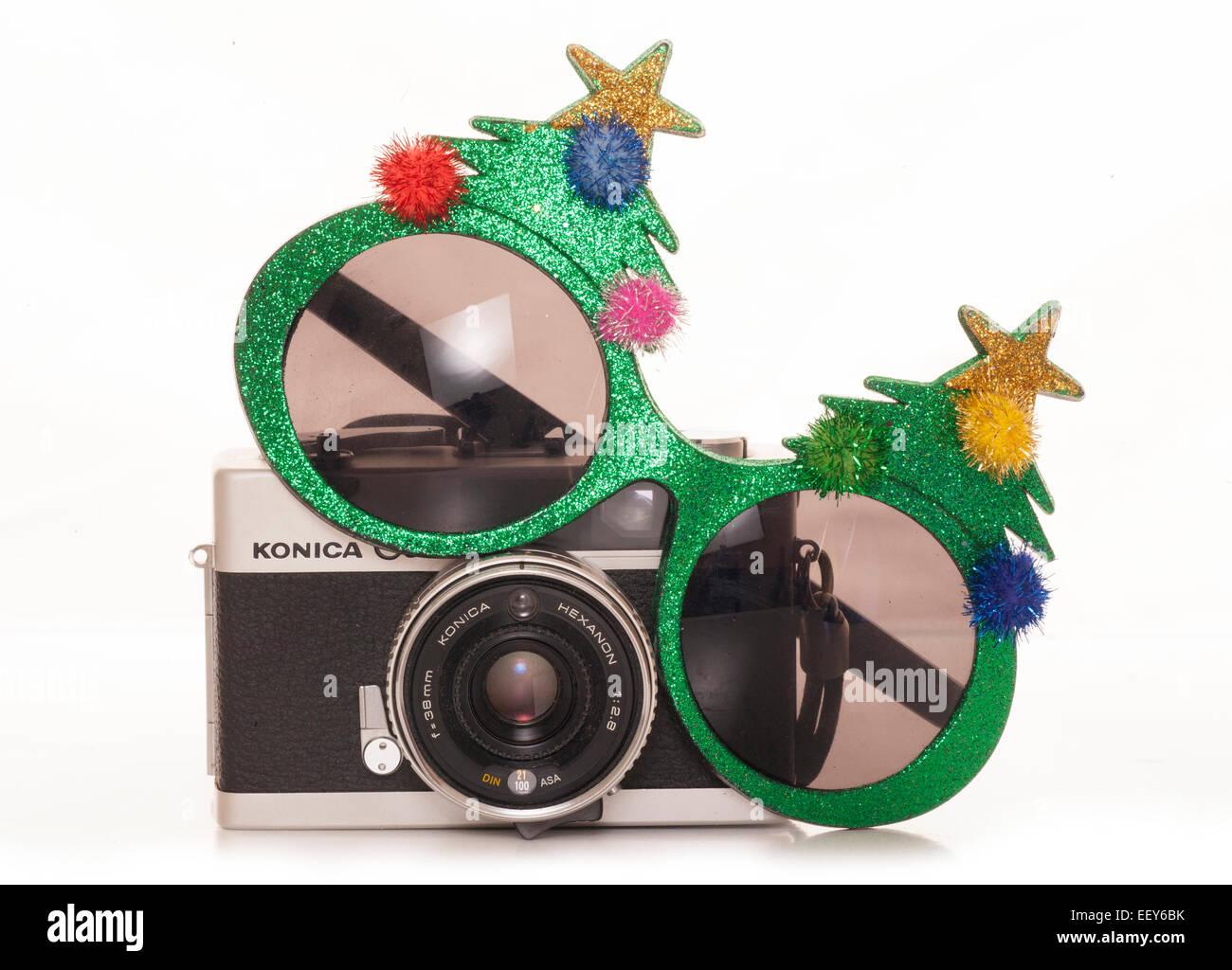 christmas tree sunglasses and vintage slr camera Stock Photo