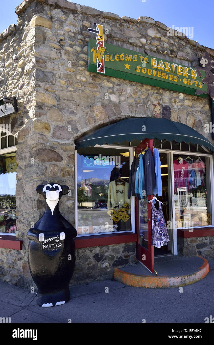 A bear statue stands in front of a souvenir store on the main street in the town of Jasper - Stock Image