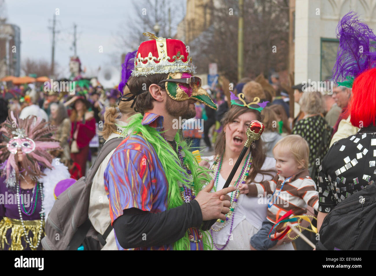 People wear costumes and colorful masks in the annual Mardi Gras parade in Asheville NC & People wear costumes and colorful masks in the annual Mardi Gras ...