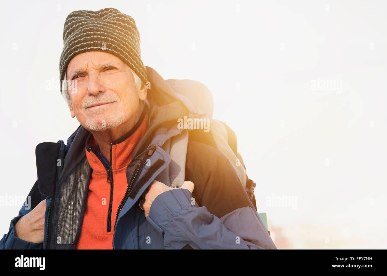 Senior man hiking - Stock Image