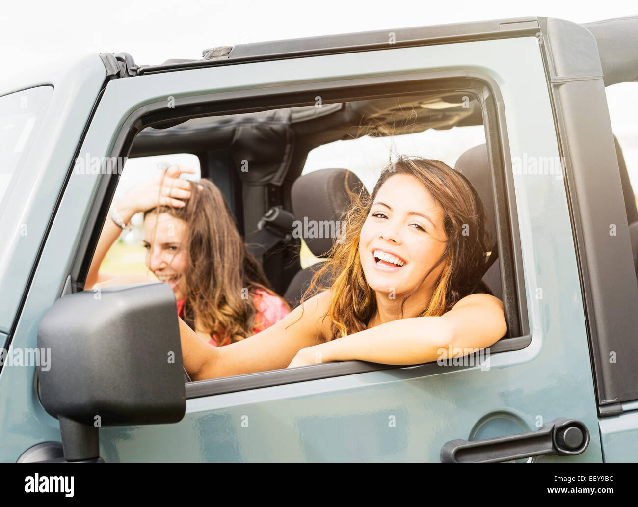Portrait of female friends (14-15) during road trip - Stock Image