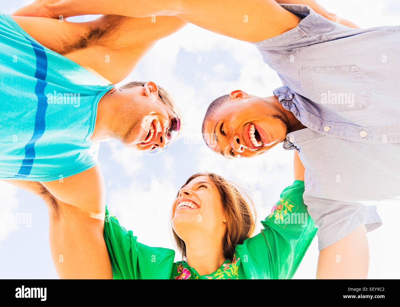 Young people with arms around each other - Stock Image