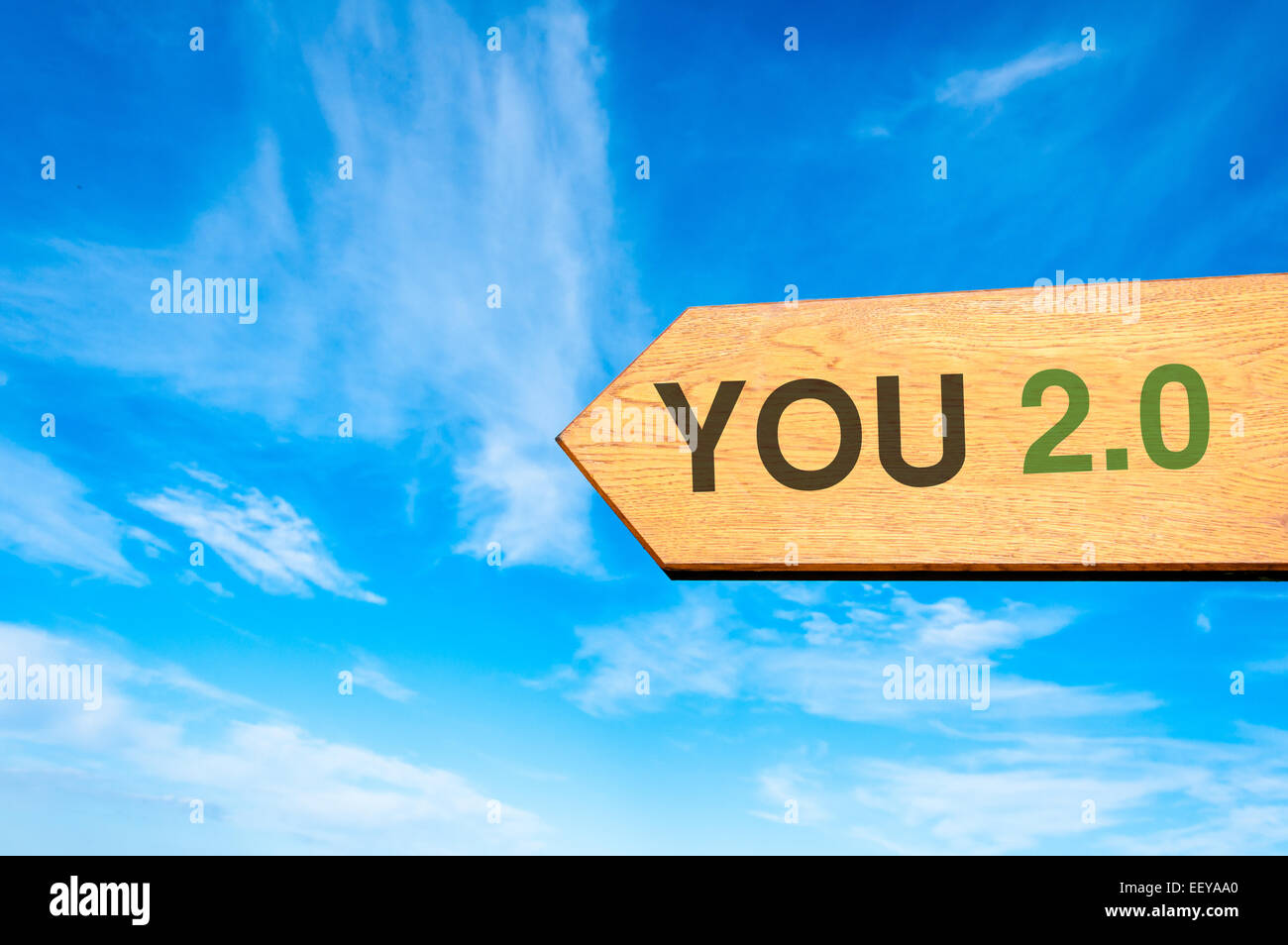 Wood arrow sign against clear blue sky with You 2.0 message, Lifestyle change conceptual image Stock Photo