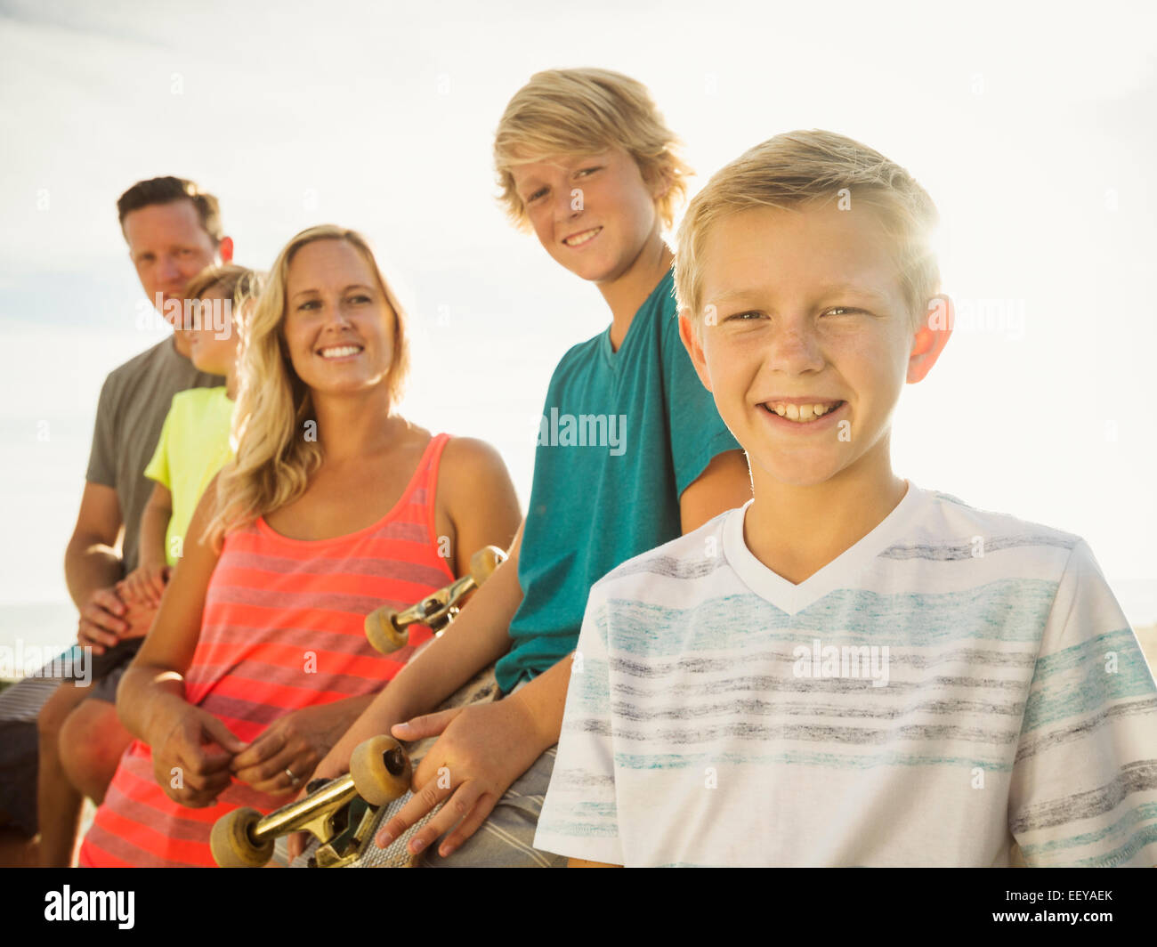 Portrait of with three children (6-7, 10-11, 14-15) on vacation - Stock Image