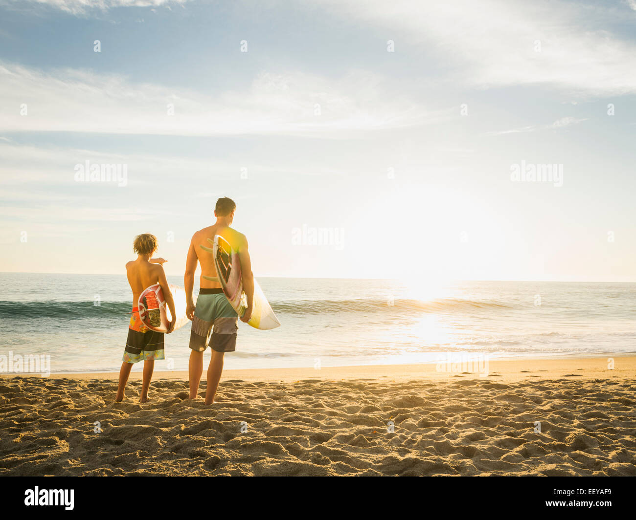USA, California, Laguna Beach, Father and son (14-15) looking at sea - Stock Image