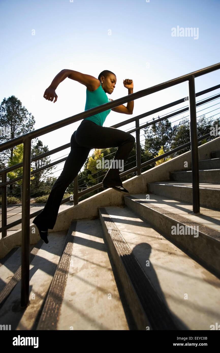USA, California, Berkeley, Woman running on steps - Stock Image