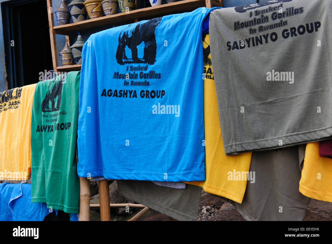 T shirts printed with the name of a gorilla group, sold in Volcanoes National Park. Kinigi. Rwanda - Stock Image