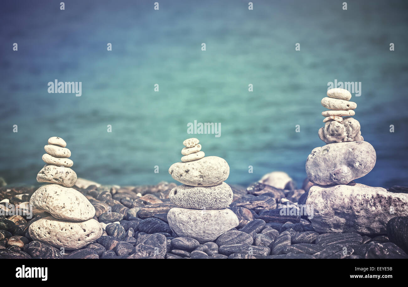 Color filtered image of stones on beach, spa concept background. - Stock Image