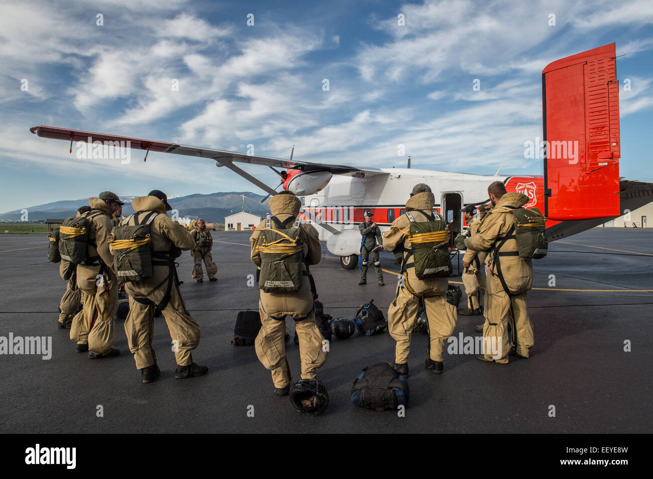 Smoke Jumpers suit up for a practice jump in  MIssoula May 23, 2014. Smoke jumping is a dangerous job where men - Stock Image