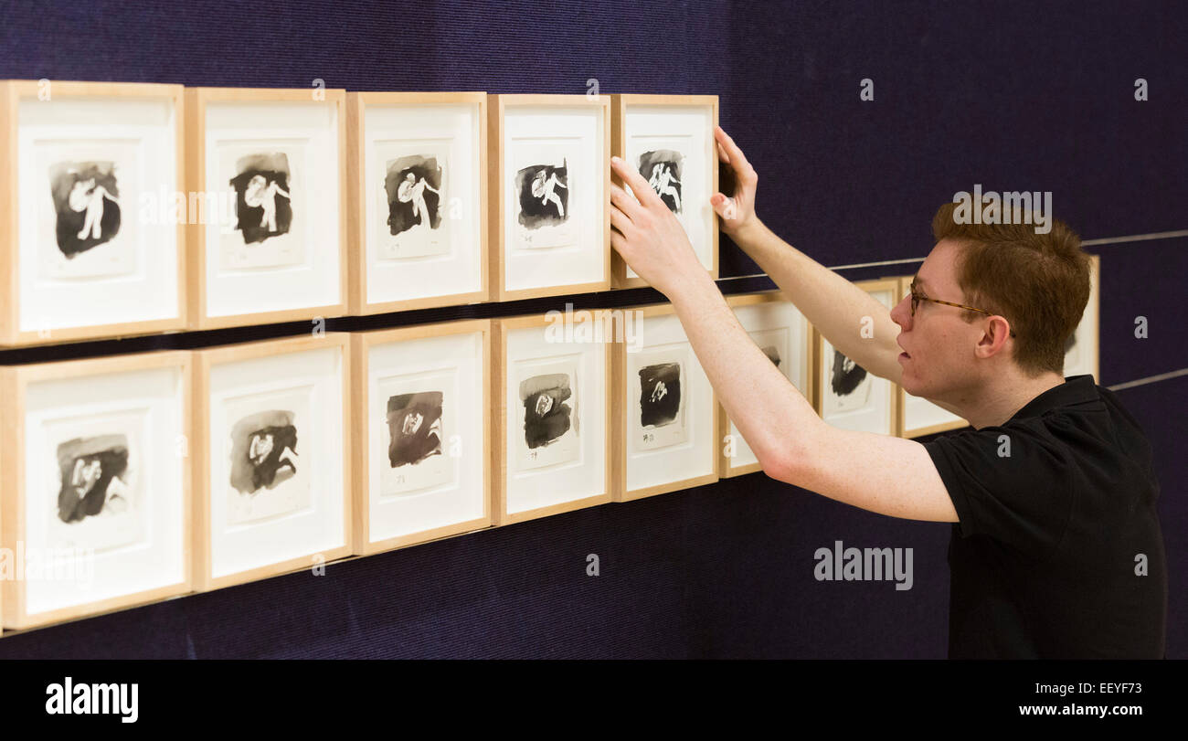London, UK. 23 January 2015. A Bonhams employee is in the process of hanging 'Untitled 84 Drawings (Four Letter - Stock Image