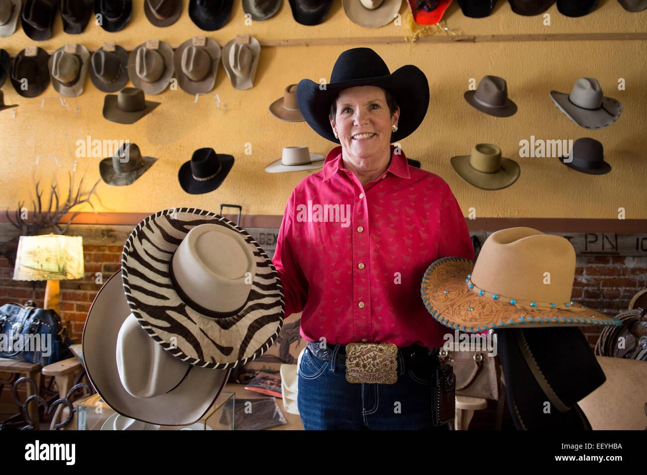 Hat Maker Sheila Kirpatrick shows off her famous creations in Twin Bridges, Montana,   June 21, 2014. Sheila keeps - Stock Image