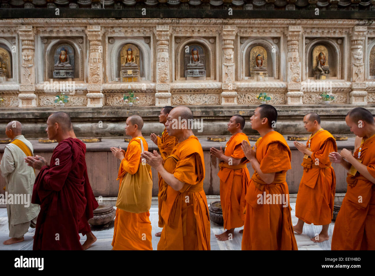 Buddhist monks encircle and pray at Mahabodhi temple, Bodh Gaya, India, a day after terrorism bomb blast on 7 July - Stock Image