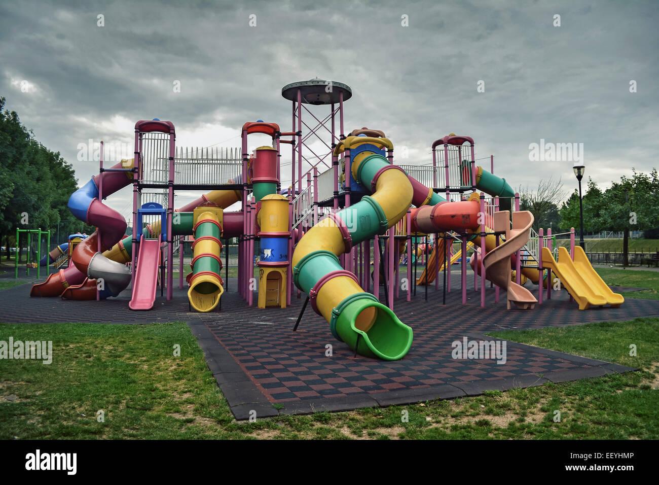 dark deserted playground on dark day - Stock Image